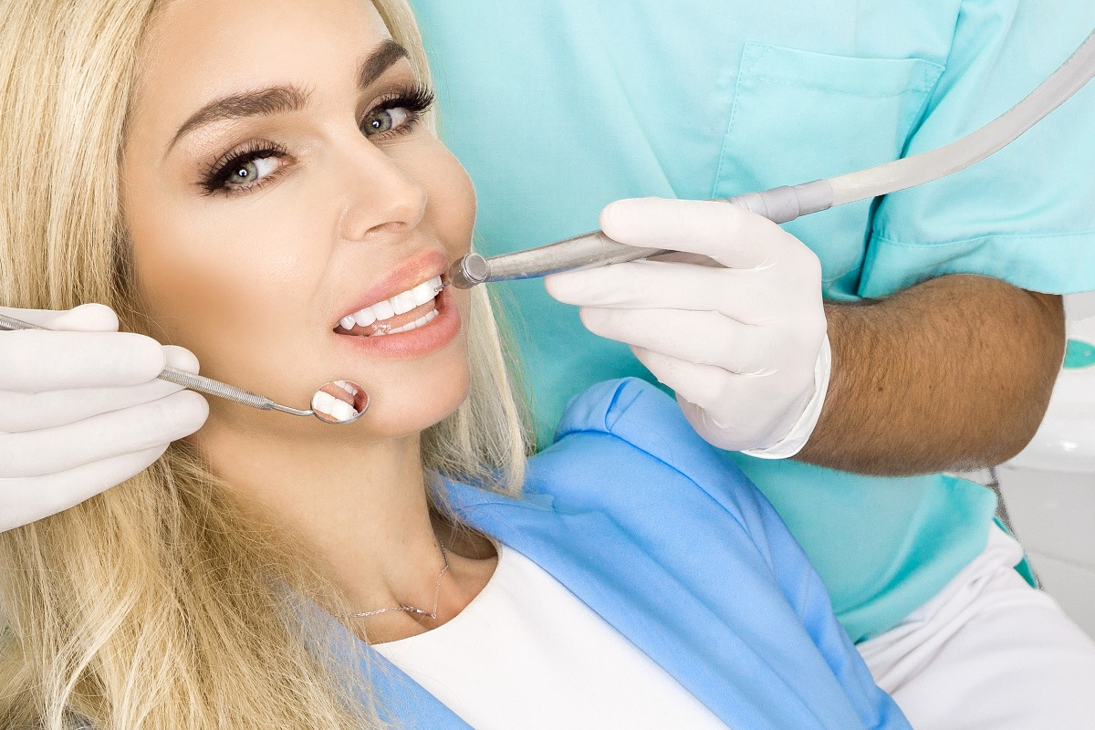 woman and a dentist