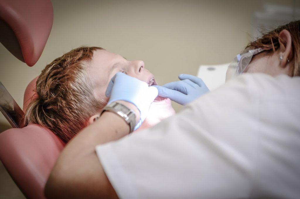 child during a dental procedure